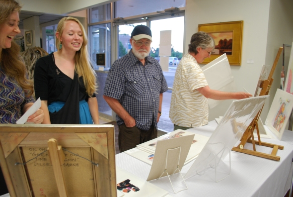 Julie (Logan Fine Art staff and enthusiastic support), Katie (the fabulous daughter), Glen (my USU illustration professor and mentor friend), and Barb (art buddy forever) at the table display of my illustrations.