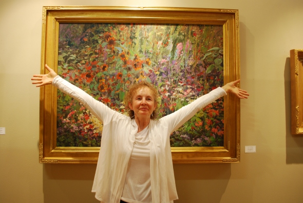 See?! Like I said, a bundle of energy! This is Susette in front of one of her very self expressed floral paintings.