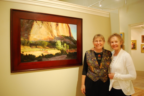 Me and Susette standing by one of MY self-expressed landscape paintings.