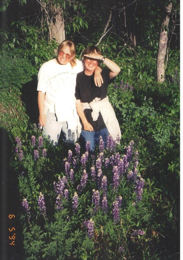 "WE THREE ""retreated"" to Barb's cabin several times in the 1990s. Fields of flowers, the comfortable warmth of a potbelly stove, and a short hop, skip, and jump from the art mecca, Jackson Hole. I am on the left and Barb is on the right."